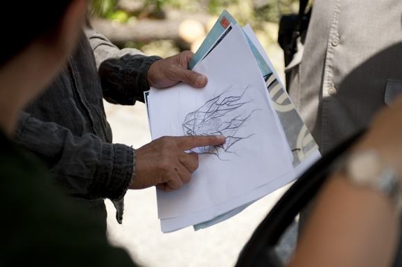 Tetsunori Kawana shows preliminary sketches of his design to Garden staff.