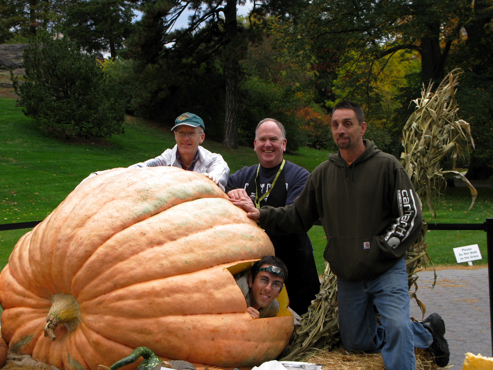 Representatives from SNEGPG (Southern New England Giant Pumkin Growers association) pose with grower Steve Connolly and pumpkin Carver Scott Cullyl.
