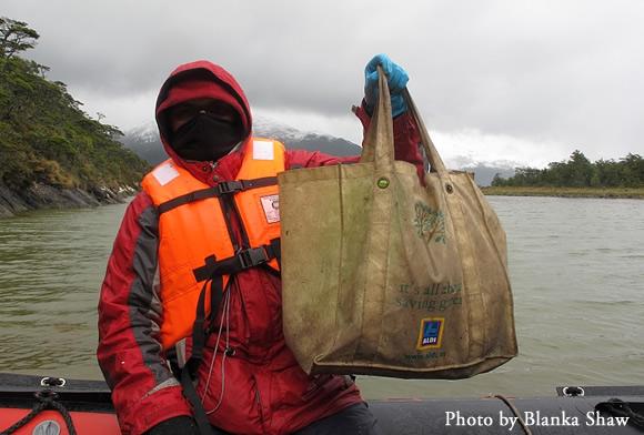 A wet, frozen, but happy Matt von Konrat dispalys a bag full of great liverworts