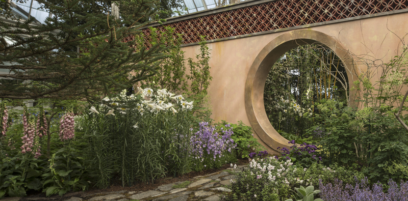 The Enid A. Haupt Conservatory's moon gate, part of NYBG's evocation of the Abby Aldrich Rockefeller Garden