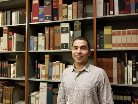 Andres Orejuela standing in front of his favored medieval works