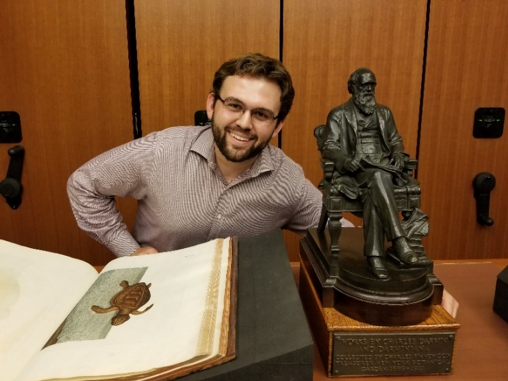 Stephen Fragano with the statue of Darwin the Mertz Library's Rare Book Room