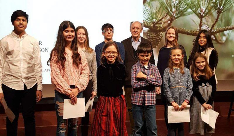 Photo of the winners of 2019's NYBG young poets contest with Billy Collins