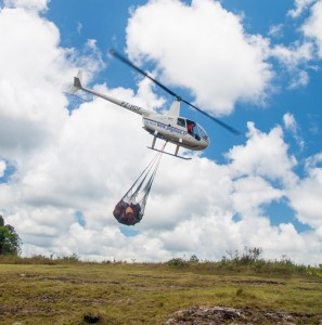 The helicopter leaves Ruddi Kappel airstrip with a sling full of cargo for the summit camp