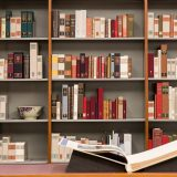 Image of books on a shelf in the Library.