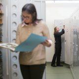 Scientists looking at herbarium samples