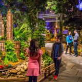 Photo of a family exploring the Holiday Train Show
