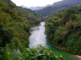 Southeast Asia river in between mountains.