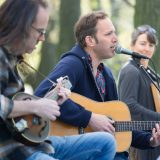 A band performs acoustically on the Garden's grounds.