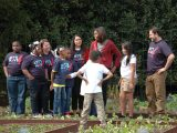 Michelle Obama with a student in the White House vegetable garden