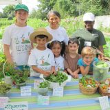 Children and NYBG staff celebrating their crop harvest.