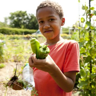 Photo of a student in the Children's Gardening Program, ECAG