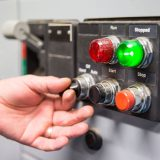 Image of a hand turning on switches
