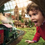 A child marves at a train at the Holiday Train Show.
