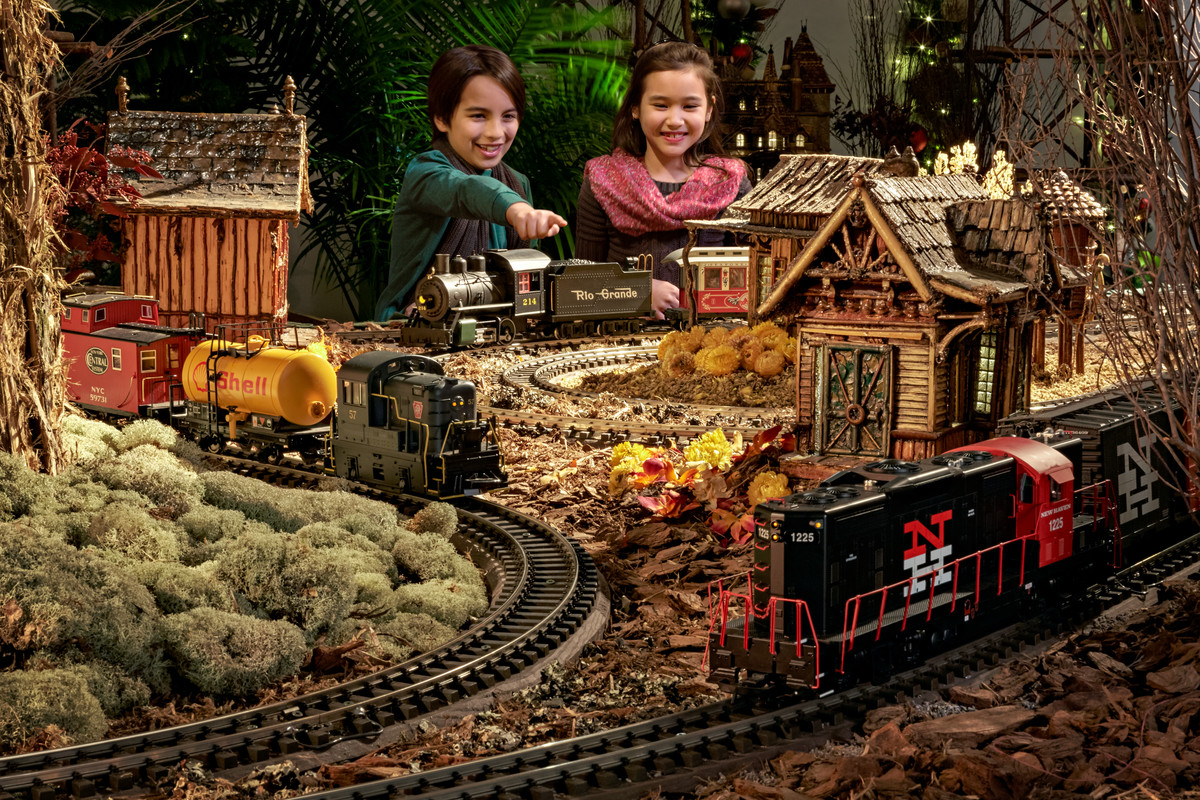 children enjoying the holiday train show - Bronx Botanical Garden Train Show