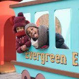 Kids riding the Evergreen Express in the Everett Children's Adventure Garden.