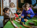 Children playing with toy trains.