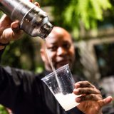 A man pouring a drink.