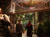 A couple walking through the Holiday Train Show during a Bar Car Night.
