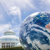Photo of a giant inflatable globe in front of the Conservatory