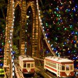 Model trains driving through a miniature model of the Brooklyn Bridge