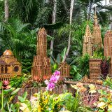 Miniature models of buildings in Midtown Manhattan surrounded by trees and plants