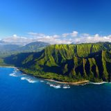 Aerial photo of an ocean and mountains in Hawaii
