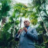 A musician playing the clarinet in the Conservatory