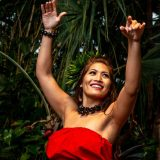 A hula performer dancing.