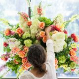 A floral designer creating an arrangement.