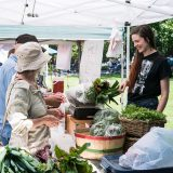 Guests buying produce at the Farmers Market