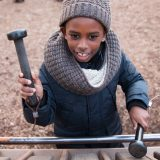 Photo of a child playing a wooden instrument