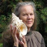 A headshot of Susan Hewitt with a gastropod shell