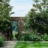 A brick gate amid lush flora.