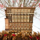 A model of the Macy's store in Manhattan made entirely out of plant parts.