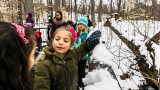 Photo of children in the forest during winter