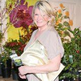 Photo of Martha Stewart in front of gardening decor