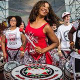 Musicians from Batala New York drumming.