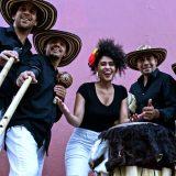 La Cumbiamba eNeYé posing with their instruments.