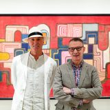 Raymond Jungles and Edward Sullivan standing in front of a Burle Marx painting.