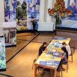 An indoor installation inspired by Sitío Roberto Burle Marx, with blue and white illustrated tiles on the walls.