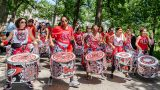 Drummers from Batala NYC walking down Tulip Tree Allée