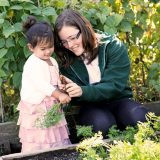 Photo of kids in the vegetable garden