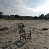 Photo of a chair washed up on a beach
