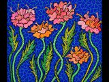 Pink and orange polka-dotted flowers set on a blue, tiled background.