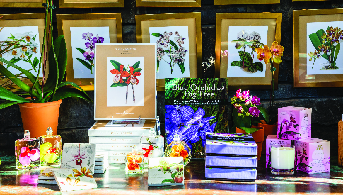 A selection of orchid merchandise, including books, prints, fragrances, and more.