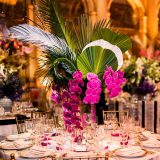 An arrangement with orchids in it