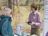 NYBG staffer orients a citizen science volunteer in the Native Plant Garden
