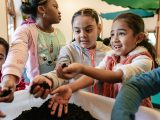 Children playing with soil