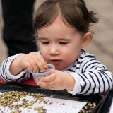Child playing with seeds